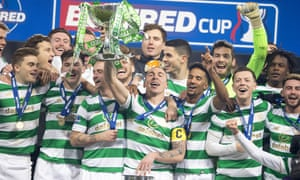 Celtic players celebrate with the trophy at Hampden.