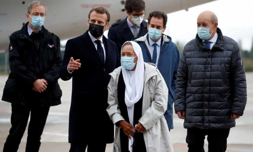 Sophie Petronin (centre) is greeted by the French president, Emmanuel Macron (second left) , on her arrival at the Villacoublay military airport near Paris