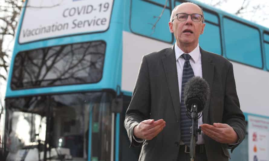Stephen Powis in front of a Covid-19 vaccination bus
