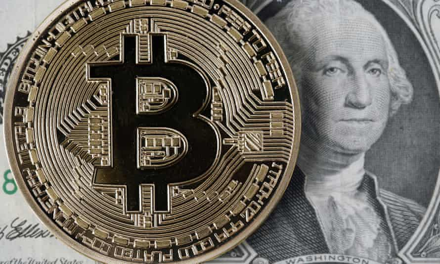 a bitcoin image sits next to a dollar note