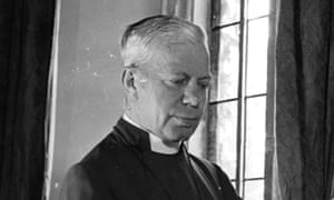 Dr George Kennedy Allen Bell  (1883 - 1958), Bishop of Chichester, in his study at Chichester Palace