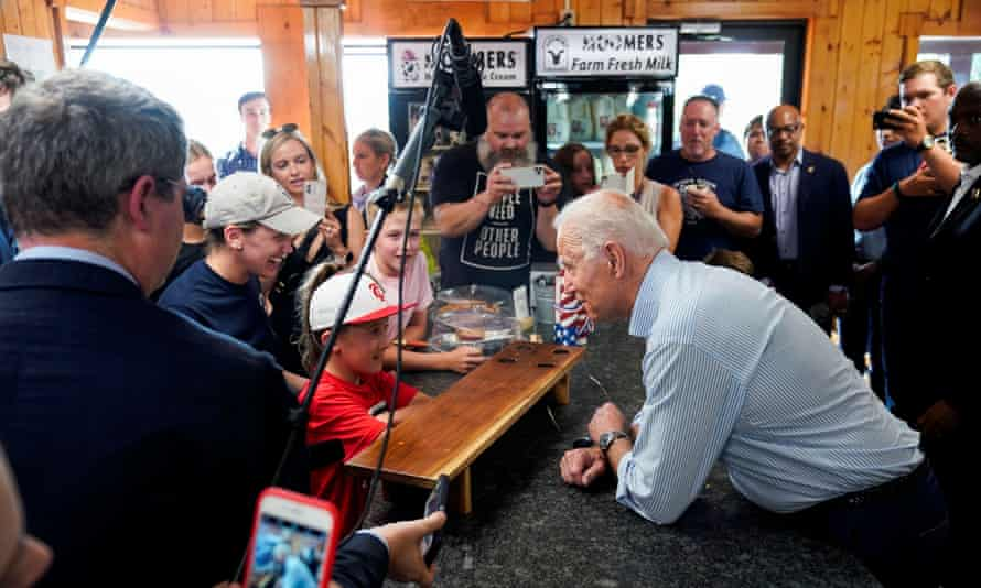 Biden speaks with a child as he visits Moomers Homemade Ice Cream, in Traverse City, Michigan.