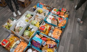 Food supplies are packed into boxes at the Play Factory children's activity centre in Skelton