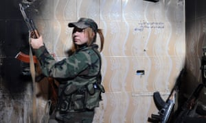 A sniper with the Syrian Republican Guard takes position in a building in Darayya.