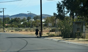 A woman and child beside the road at the Hidden Valley town camp near Alice Springs