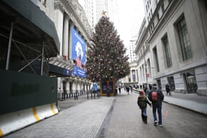 A giant Christmas tree stands at the entrance to the New York Stock Exchange on Wall Street.