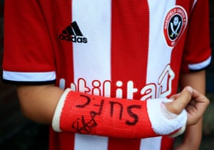 A Sheffield United fan with his broken arm in a plaster-cast is pictured getting autographs before their match with Southampton. His side conceded a fine individual goal to Moussa Djenepo before having Billy Sharp sent off for a bad challenge.