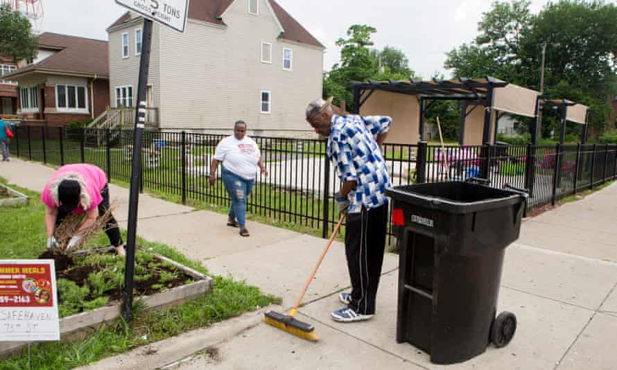 Residents clean up the streets in Englewood, Chicago, where abandoned lots have been turned into urban farms