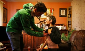 Luke Skellern checks patient Joe Cafferky