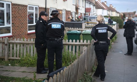 Police outside a property in Stanwell, Surrey