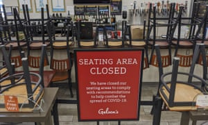 In this March 2020 file photo, an indoors sitting bar is closed inside the Gelson's Market in Los Feliz neighbourhood of Los Angeles.