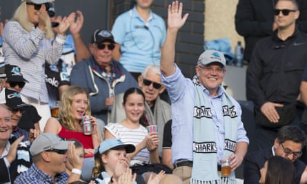 Scott Morrison waves to the crowd during a Cronulla Sharks match