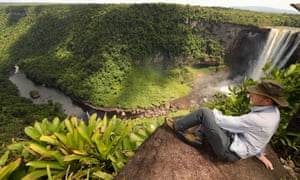 Kevin Rushby sitting above Kaieteur Falls