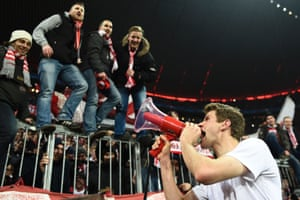 Thomas Müller celebrates with the Bayern fans.