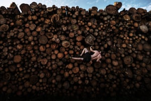 Georg Filser-Mayerhofer of Germany climbs a log pile while doing some bouldering training in Kochel Am See, Germany
