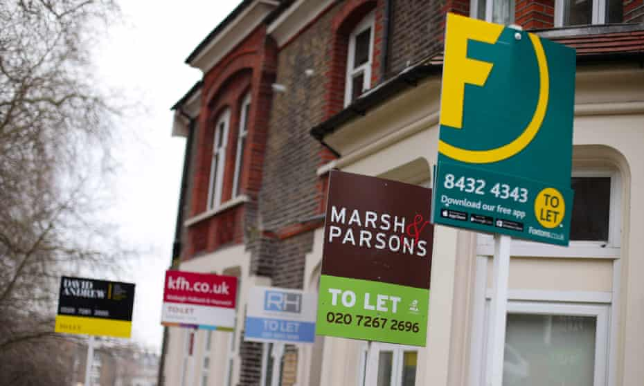 Estate agent signs placed outside houses in north London.