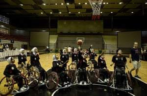 Afghanistan's women's wheelchair basketball team warm up on court during the qualifying tournament for the Asia Para Games in Bangkok in 2012.