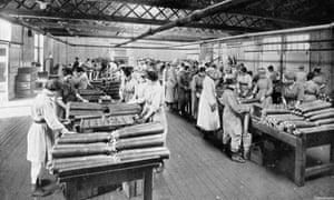 Women assembling shells in a munitions factory.