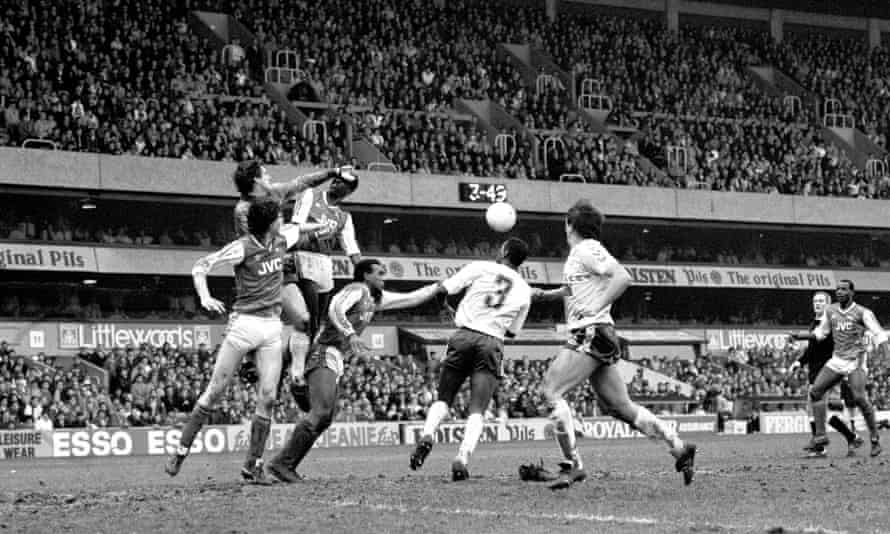 Spurs goalkeeper Ray Clemence clears the ball during the second leg of the League Cup semi-final.