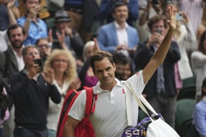 Roger Federer waves to the crowd as he leaves the court after losing to Poland's Hubert Hurkacz.