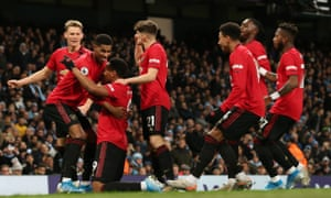 Martial celebrates with teammates after scoring United's second goal.