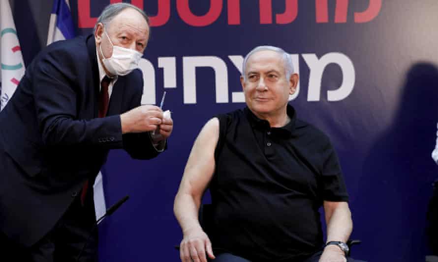 Israel's prime minister, Benjamin Netanyahu, receiving a Covid-19 vaccine on Saturday.