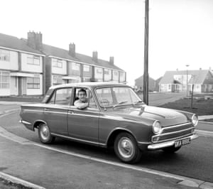 Liverpool footballer Ian St. John with his new Ford Cortina in Liverpool 1965.