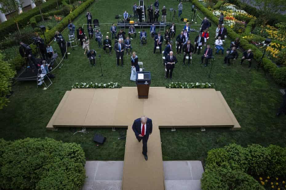 Donald Trump departs after speaking in the Rose Garden.