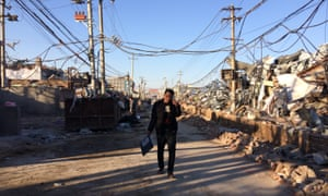 Xinjian village, a once-teeming neighbourhood of garment factories and migrant dwellings in Beijing that has been partially demolished as part of the housing crackdown