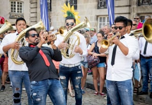 People enjoy the entertainment from the group Orkestar Kemi Asanov at Place du Martouret