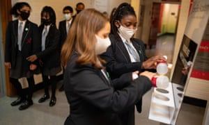 Pupils sanitise their hands at Moor End Academy in Huddersfield, West Yorkshire.