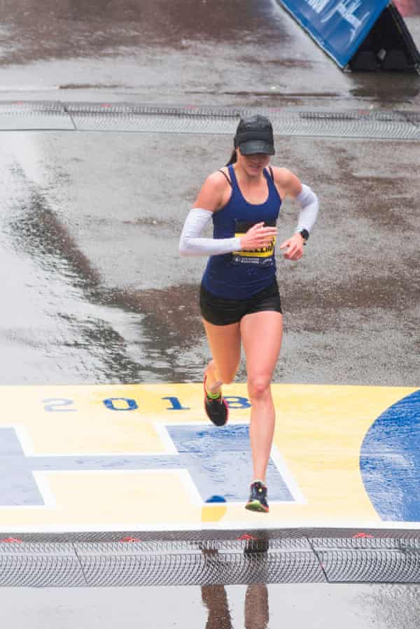Sarah Sellers crosses the finish line.