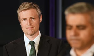 Zac Goldsmith (left) looks on as Labour Party mayoral candidate Sadiq Khan delivers a speech.