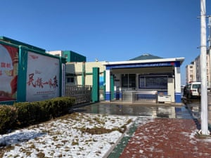 The Uighur workers must enter and exit the factory compound through a special police station equipped with facial recognition cameras and other high-tech surveillance. The signs on the outside say in Uighur language that it is a People's Service Hall.