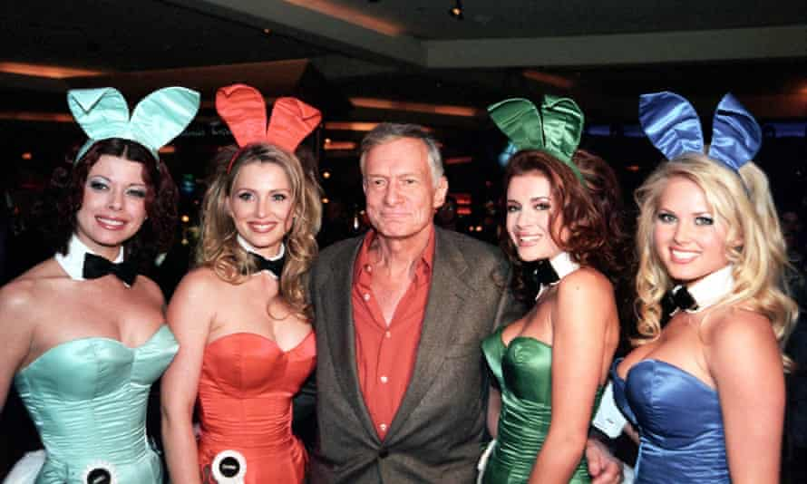 Playboy magazine founder Hugh Hefner with some of his Bunnies