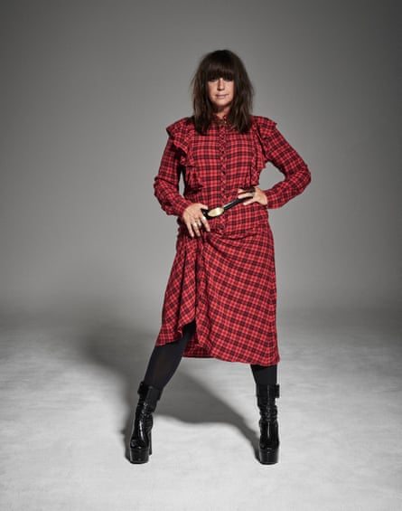 Cat Power in a black and red checked dress and black boots