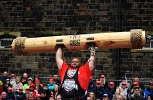 Paul Carter lifts a log