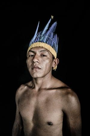 Estenio da Silva, 24, is the son of Orlando, the tuxaua of the Uiramutã indigenous community