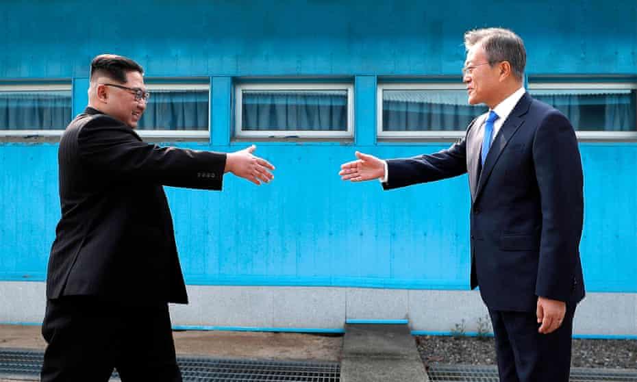 North Korean leader Kim Jong-un prepares to shake hands with the South Korean president Moon Jae-in at Panmunjom.