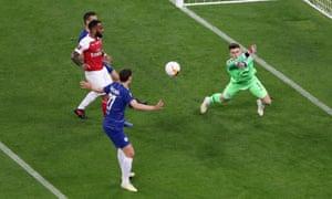 Chelsea's Kepa Arrizabalaga punches clear.