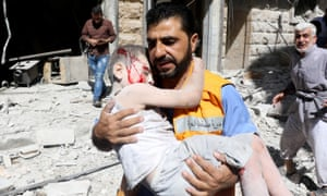 A child is rescued after bombing by Syrian forces on the opposition-controlled Mashhad district of Aleppo on 25 July.