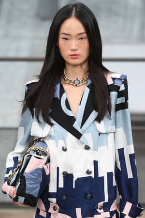 A model in a new version of Chanel's classic costume.