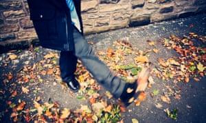 Child kicking leaves