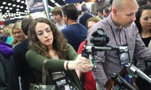 Gun enthusiasts look over Smith & Wesson pistols at the NRA Annual Meetings & Exhibits in May.
