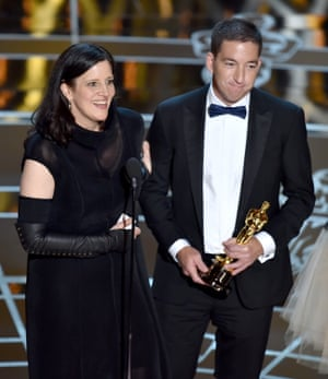 Poitras and Glenn Greenwald accept best documentary for Citizenfour.