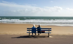 An elderly couple looking out to sea, Bournemouth, Dorset,