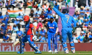 Hashmatullah Shahidi of Afghanistan survives a stumping attempt by MS Dhoni of India.