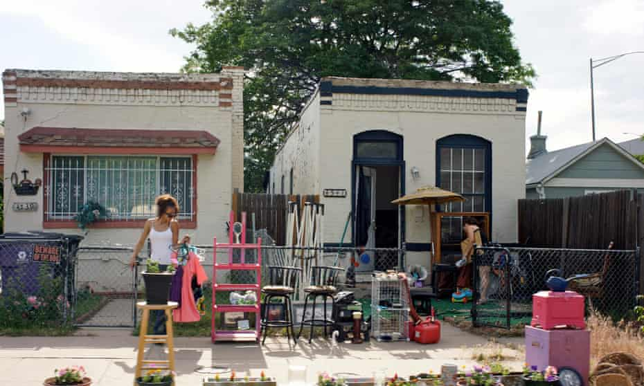 Narrow house yard sale. Denver gentrification story for cities