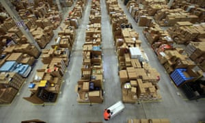 An Amazon warehouse. The company's CEO, Jeff Bezos, denies that 'our intentional approach is to create a soulless, dystopian workplace where no fun is had and no laughter heard'.