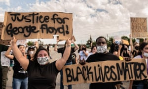 Protestors demonstrate while they shut down Highway 101 in both directions in San Jose, California, on 30 May 2020 after the death of George Floyd.